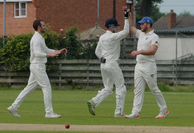 Ludlow fielder Luke Miles (right) is 'high fived' by team-mate Sam Roberts