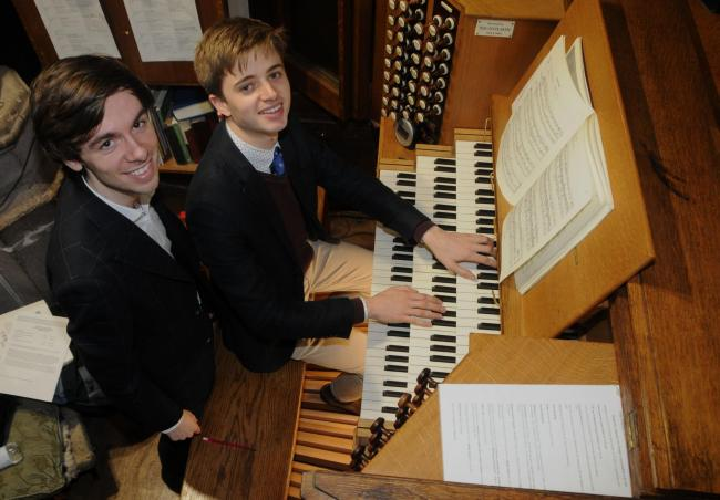 Callum Alger and seated Joshua Roebuck prepare for the organ recital at St Laurence's Church in Ludlow.