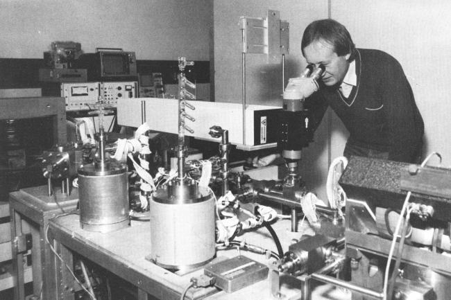 Dr Grenville Turner studying rock samples from the moon