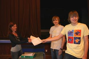 Sarah Steer, Head of Science, hands out the their results to twins James (1 x A*, 4 x As and 3 x Bs) and Sam Mann ( 1 x A*, 5 As, 1 x B).