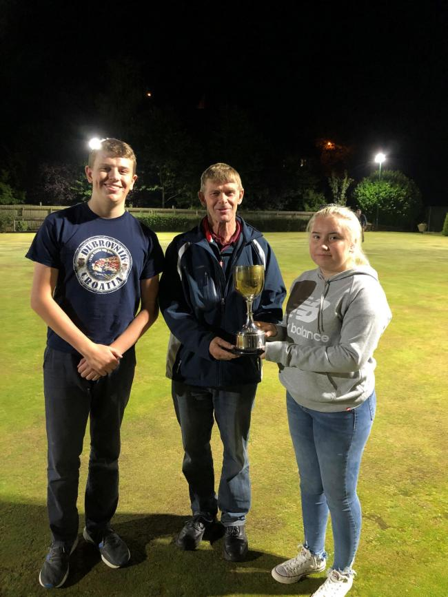 Camilla Parsonage receives the Flowfit Ludlow and District Bowls League Junior title from league chairman Wayne Rogers along with finalist George Cooper