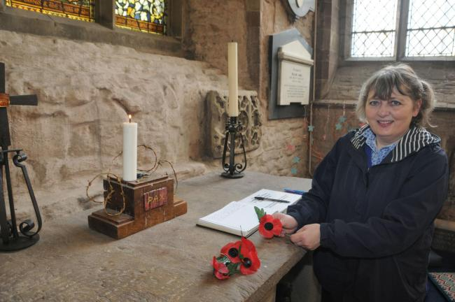 Margaret Edwards gets ready for Remembrance Sunday