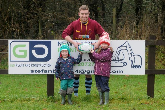 Clee Hill skipper Charlie Evans accepts the Barney Brick Memorable Match ball from two of Barney's grandchildren, Oli and Grace Brick, prior to their last home game of 2019 against Yardley & District.