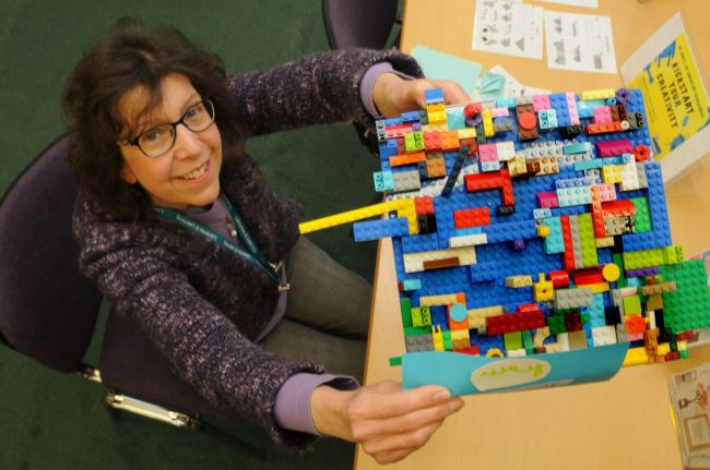 Youngsters and their parents made numerous models including this impressive 'Lego Town' held up by library assistant Yvonne Bradley.