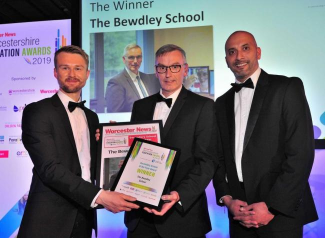 editor Michael Purton presents Bewdley School Headteacher Dave Hadley Pryce with the award at the Worcester News Worcestershire Education Awards 2019, held at the University of Worcester Arena. Pic Jonathan Barry 20.6.19