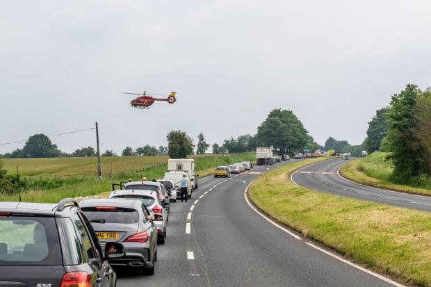 Ludlow Advertiser: The air ambulance landing near to the scene of the crash in May 2018. Photo by Paul Hickey