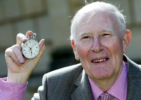 SPORTING CELEBRATION: Sir Roger Bannister holding the stop-watch that recorded his sporting feat on the 50th anniversary of the first sub-four-minute mile Picture: PA Mark Lees