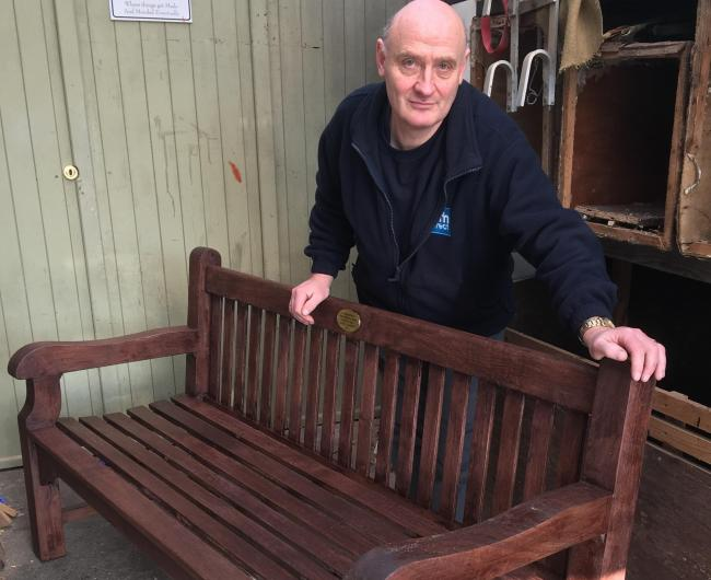 Graeme Perks with one of the benches he has repaired