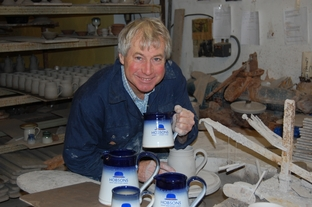 Mike Fletcher from Wenlock Pottery with the new range of Hobsons tankards and jugs.