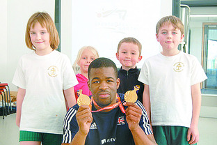 Sprinter Leon Baptise shows his two gold medals that he won at the Commonwealth games in Delhi to from left Jemma Radmore, Leona Stokes, Harvey Barker and Elliot Booth.