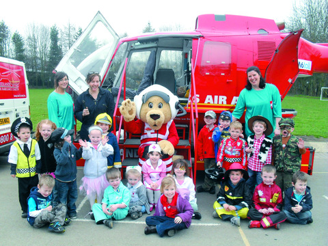 Reception pupils at St Laurence's Primary School enjoy a visit from the air ambulance team