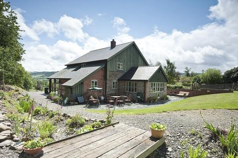 A charming converted barn set in Montgomery, Powys, with option to buy extra land