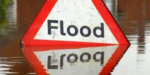 Cars, vans and lorries became trapped in flood water at Lindridge.