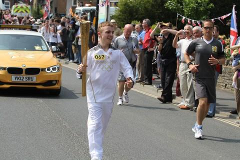 Mathew Clarke carries the torch through Ludlow.