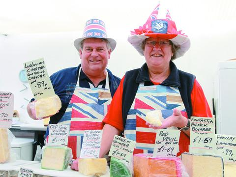 Mark and Bella Woodward sell their cheese selection in Jubilee regalia.
