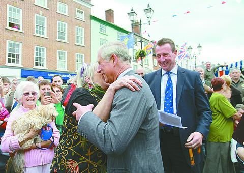 Lyn Bailey gives the Prince of Wales a kiss. 123864-15.Pictures by Keith Gluyas