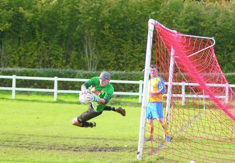 Tenbury goalkeeper Sean Baldwin makes a flying save in Saturday's hammering. 124361-18. By Keith Gluyas