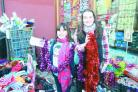 Rosie and April Preece buying tinsel from Pot Luck