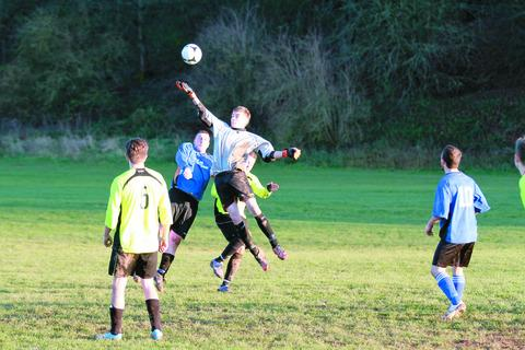 Tenbury Colts' Luke Grill stretches to put a Leintwardine cross safely over the bar. 125062-1 Picture: Keith Gluyas