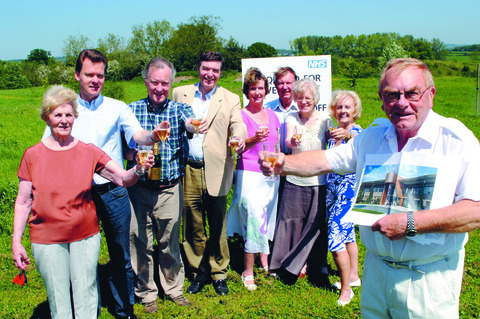 Peter Corfield and fellow League of Friends campaigners toast the hospital project last May.