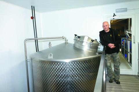 Peter England with the extra fermenting/conditioning tank installed to cope with the increased volume of business. 130256-1.