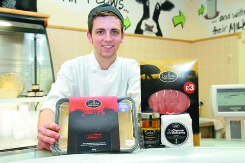 Cameron Stevens at the Food Centre with a selection of items packaged with the new branding. 130257-1