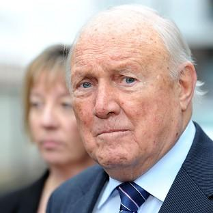 Former TV presenter Stuart Hall reads a statement outside Preston Magistrates' Court