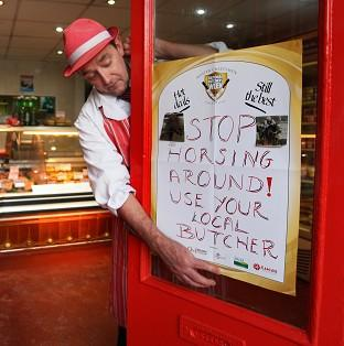 George Emond of Halliwells Selkirk, in the Scottish Borders, puts up his posters advertising local butchers as the horsemeat scandal continues