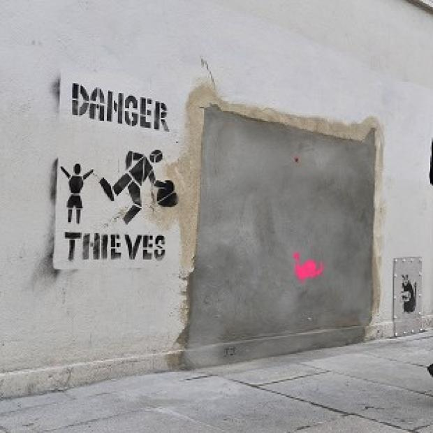 A section of wall where a Banksy mural was removed from the side of a Poundland shop in mysterious circumstances