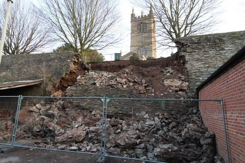 Part of the town wall, which collapsed last week.