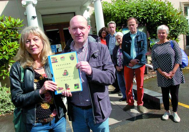 Author Deborah Moggach with Mark Ferrero and supporters hand in a petition against possible changes to Leintwardine Library. 133702-1.