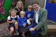 Philip Dunne with reception and year one teacher Susan Rook and pupils Harry Chapman, Joy Hall, and Maddie Matts.