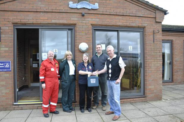 Eddie Jones (community first responder), Dawn Bush (West Midlands Ambulance Service), Priscilla Toop (community first responder, Ludlow Heart Start), Russell Price and Peter Clements (Ludlow Golf Club).