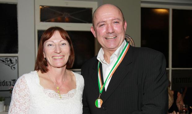 Ludlow Advertiser: Physiotherapist Liz Boland presents a medal to Martin 'Paddy ' Brennan for the work he has put into the new boxing academy.Photograph by Keith Gluyas.