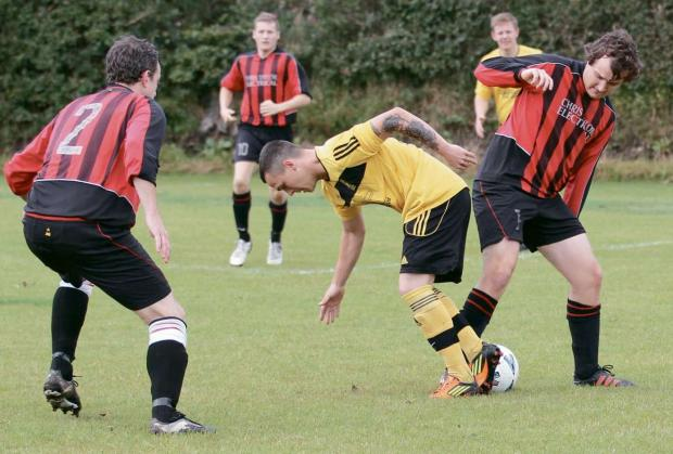 Ludlow Advertiser: Liam Whitbread, pictured making a tackle, scored Clee Hill's second goal against Dawley Town.