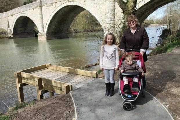 Ludlow Advertiser: Amber and Faith Langston with their nan Lindsay Beavon, take a stroll along the new pathway with a fishing platform for disabled anglers alongside.