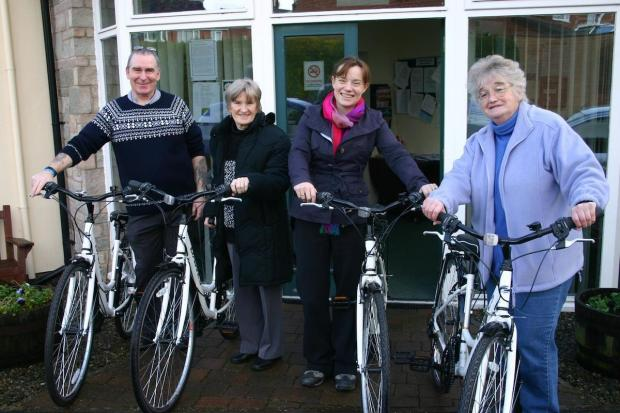 Getting to grips with the new bikes ahead of the first spring rides are: Ray Hughes, project officer for Travel Shropshire; resident Sheila Hawkes; Councillor Charlotte Barns; and resident Carol Clarke.