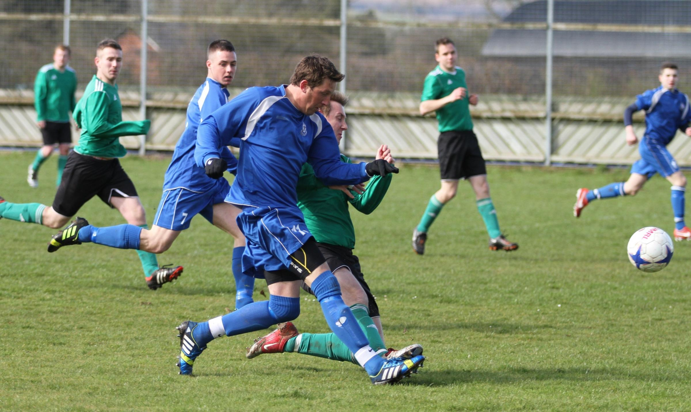 Woofferton's seven-goal hero Danny Gower powers past an Orleton Colts Reserves' player. Photograph by Keith Gluyas.
