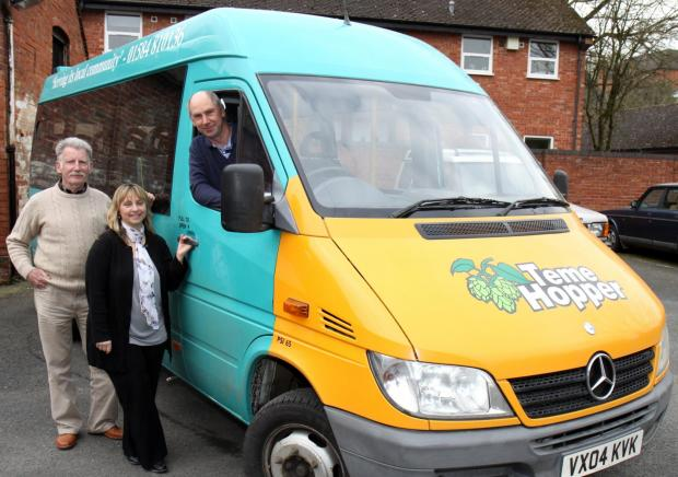 John Driver (chairman) and Carole Collier (co-ordinator) are pictured with driver Roy Lewis behind the wheel of the Teme Hopper mini-bus.