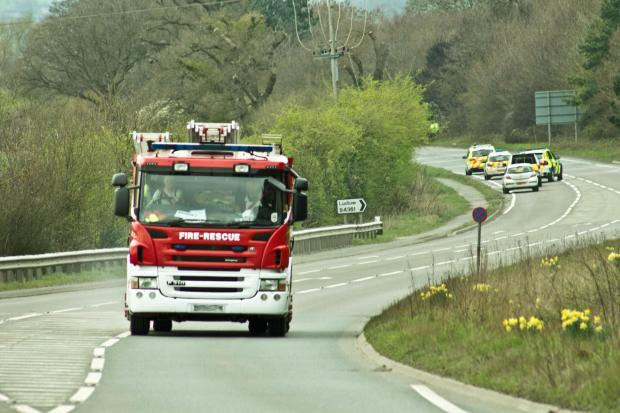Emergency services work at the scene following a fatal accident north of Ludlow.