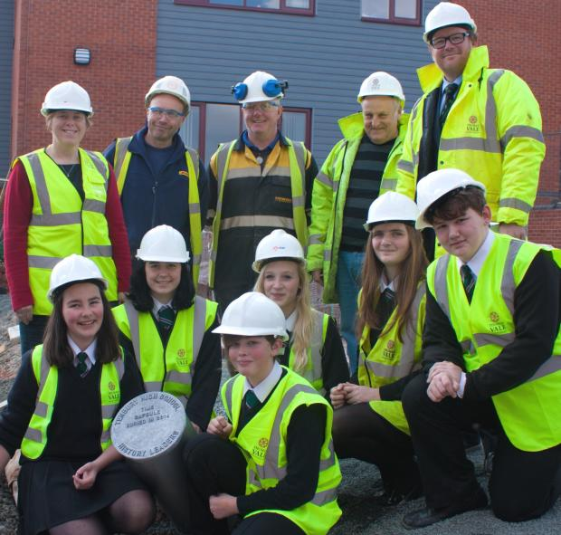 Back Row:  Kate Loupart, head of history, with three representatives from Thomas Vale Construction, and headteacher  Adrian Price; Middle row, Hollie Griffiths, Eve Watson, Silke Everitt, Kitty Houchin and Tom Wall; with Sophie Reynolds at the front.