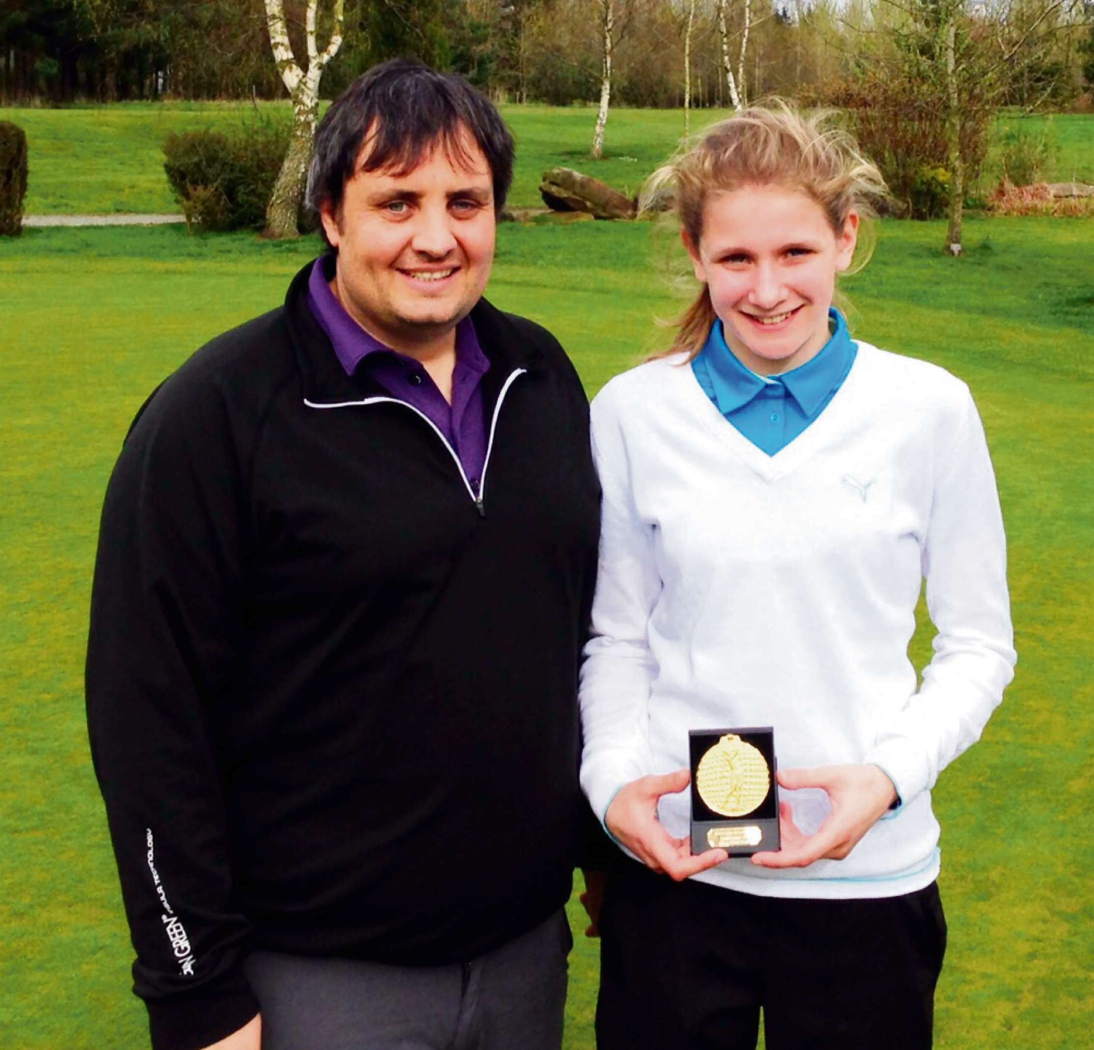 Emily Price with Kristian Wood, the tournament organiser and Lacon Childe School head of sport.