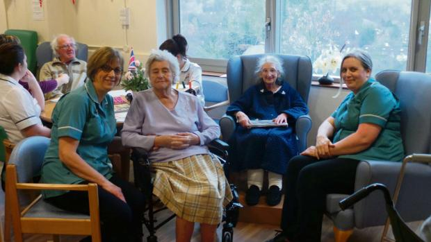Jan Benjamin, physiotherapy rehab technician, and Carol White, physiotherapy rehab technician, with patients at Ludlow Hospital.