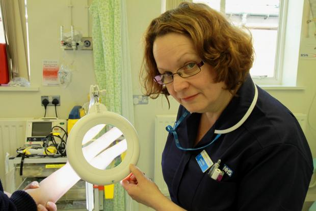 Ludlow Advertiser: Lead Nurse Jayne Willis has a close look through the magnifying glass. Photos by Keith Gluyas.