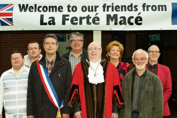 Visitors from La Ferte Mace were welcomed to Ludlow. The party included (front from left to right) Jacques Dalmont (mayor of La Ferte Mace), Councillor Jim Smithers (mayor of Ludlow) and Yvon Jestin (chair of La Ferte Mace's Twinning Association).