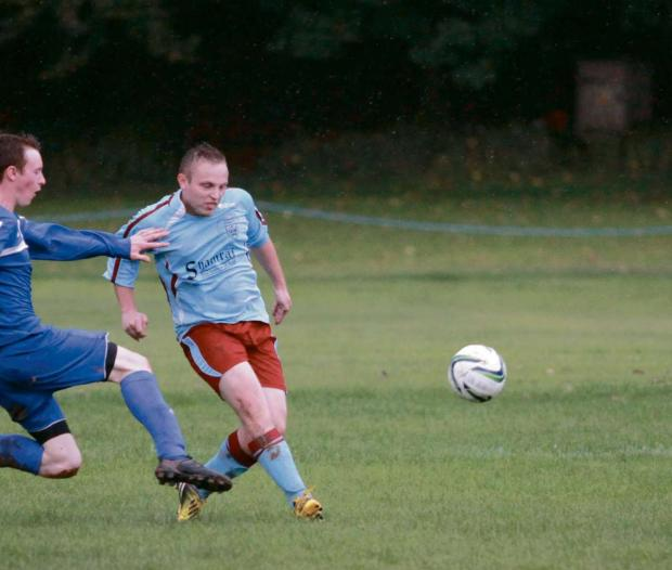 Mark Boucker, pictured, score a brace in Tenbury Town's cup semi-final defeat.