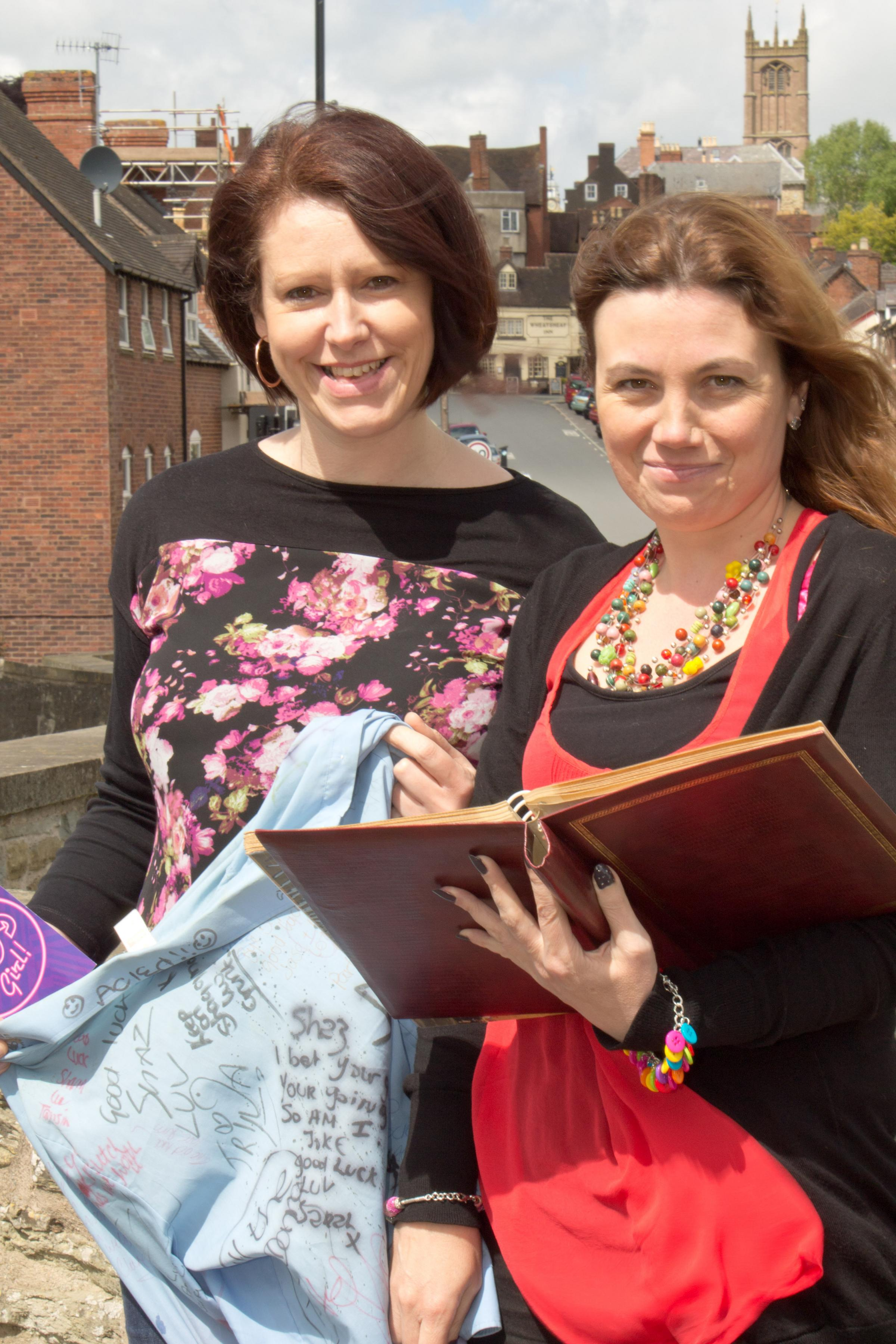 Looking at a book of memories from their school days are Sharon Turner, clutching her old school shirt, and Tracey Chidley. Picture by Mark Bowen.