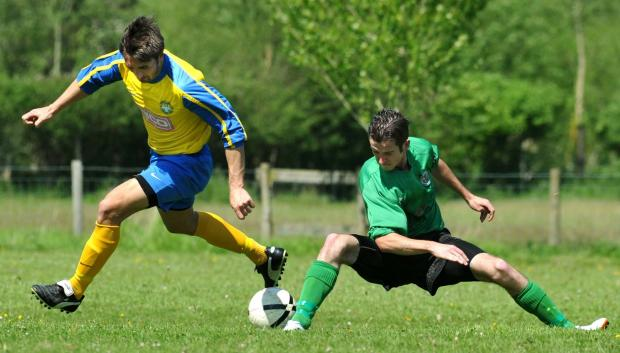 Ludlow Advertiser: Tenbury United's Ryan Morris (left) battles with Orleton Colts' Kyle Whittacase.Picture by Chas Breton. (6318831)