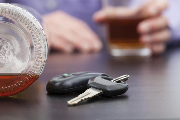 Car keys near the bottle of alcohol (6788144)