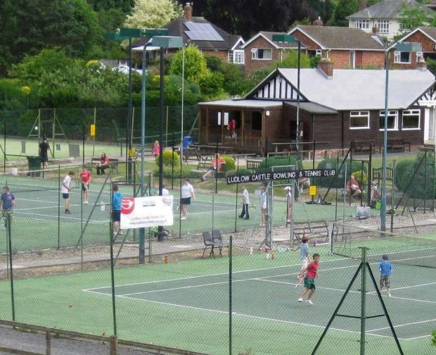 Junior players are pictured enjoying coaching last year at Ludlow Castle Tennis Club.